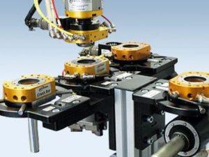 Robotic machine tending solutions, quick-change tooling.